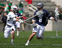 Michael Crimmins (13) of Loyola applies pressure to Andrew Brancaccio (8) of Georgetown at the Ridley Athletic Complex in Baltimore, MD.  Loyola defeated Georgetown, 11-6.