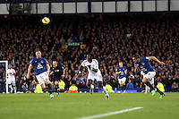 Liverpool, UK. Saturday 01 November 2014<br /> Pictured: Bafetimbi Gomis of Swansea (C) receives a lob pass, he is marked by Ross Barkley (L) and Phil Jagielka (R) of Everton. <br /> Re: Premier League Everton v Swansea City FC at Goodison Park, Liverpool, Merseyside, UK.