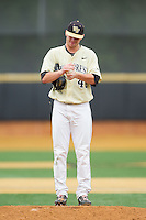 Wake Forest Demon Deacons starting pitcher Connor Kaden (40) rubs up the baseball during the game against the Virginia Cavaliers at Wake Forest Baseball Park on May 17, 2014 in Winston-Salem, North Carolina.  The Demon Deacons defeated the Cavaliers 4-3.  (Brian Westerholt/Four Seam Images)