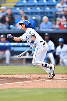 Asheville Tourists second baseman Matt McLaughin (5 ) swings at a pitch during a game against the Greensboro Grasshoppers at McCormick Field on May 11, 2018 in Asheville, North Carolina. The Tourists defeated the Grasshoppers 10-5. (Tony Farlow/Four Seam Images)