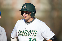 Zach Jarrett (10) of the Charlotte 49ers looks to his first base coach for the sign during the game against the Louisiana Tech Bulldogs at Hayes Stadium on March 28, 2015 in Charlotte, North Carolina.  The 49ers defeated the Bulldogs 9-5 in game two of a double header.  (Brian Westerholt/Four Seam Images)