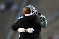 CHAPEL HILL, NC - NOVEMBER 23: Former UNC player Torin Dorn is embraced by Myles Dorn #1 of the University of North Carolina as he is honored on the field during a timeout during a game between Mercer University and University of North Carolina at Kenan Memorial Stadium on November 23, 2019 in Chapel Hill, North Carolina.