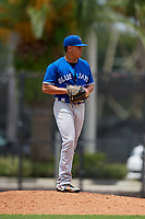GCL Blue Jays starting pitcher Alejandro Melean (18) gets ready to deliver a pitch during a game against the GCL Phillies East on August 10, 2018 at Carpenter Complex in Clearwater, Florida.  GCL Blue Jays defeated GCL Phillies East 8-3.  (Mike Janes/Four Seam Images)