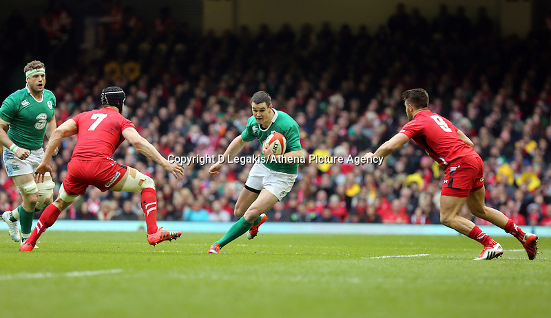 Pictured: Johnny Sexton of Ireland (C) against Sam Warburton (7) and Rhys Webb (R) of Wales Saturday 14 March 2015<br /> Re: RBS Six Nations, Wales v Ireland at the Millennium Stadium, Cardiff, south Wales, UK.