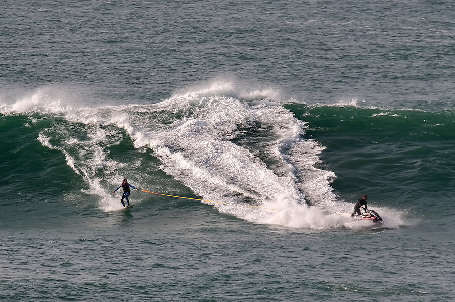 Surfer Ben Skinner towing into The Cribbar, Newquay, on October 30th 2011 #13. Cornwall's legendary big wave only occurs under precise conditions of a huge swell, a very long swell period, a particular swell direction, and a southeast wind, meaning that it only appears 2 or 3 times a year.