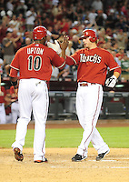 Apr. 14, 2009; Phoenix, AZ, USA; Arizona Diamondbacks pinch hitter Mark Reynolds (right) is congratulated by Justin Upton after hitting a two run home run in the fifth inning against the St. Louis Cardinals at Chase Field. Mandatory Credit: Mark J. Rebilas-