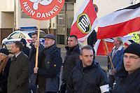 Zum 75. Jahrestag der Reichspogromnacht marschierten bis zu 200 Neonazis von der NPD durch die mecklenburgische Kleinstadt Friedland und protestierten gegen ein geplantes Fluechtlingsheim.<br />Mehrere hundert Gegendemonstranten demonstrierten lautstark gegen den Aufmarsch.<br />300 Polizeibeamte sicherten den reibungslosen Ablauf der NPD-Veranstaltung.<br />Links mit braunem Mantel: Udo Pastoers, Fraktionsvorsitzender der NPD im Mecklenburger Landtag und Mitglied im Bundesvorstand der NPD.<br />Mit rundem Plakat: Stefan Koester, NPD-Landtagsabgeordneter MV, NPD-Bundesgeschaeftsfuehrer, Wiking Jugend (WJ).<br />Rechts neben Koester: Marko Mueller, Ordnungsdienst NPD-MV.<br />Vorne 2.vr mit Ordnerbinde: Marko Mueller, NPD-Ordnungsdienst NPD-MV.<br />9.11.2013, Berlin<br />Copyright: Christian-Ditsch.de<br />[Inhaltsveraendernde Manipulation des Fotos nur nach ausdruecklicher Genehmigung des Fotografen. Vereinbarungen ueber Abtretung von Persoenlichkeitsrechten/Model Release der abgebildeten Person/Personen liegen nicht vor. NO MODEL RELEASE! Don't publish without copyright Christian Ditsch/version-foto.de, Veroeffentlichung nur mit Fotografennennung, sowie gegen Honorar, MwSt. und Beleg. Konto:, I N G - D i B a, IBAN DE58500105175400192269, BIC INGDDEFFXXX, Kontakt: post@christian-ditsch.de.<br />Urhebervermerk wird gemaess Paragraph 13 UHG verlangt.]