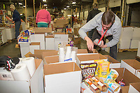 Some of the  food for being sent out on the trail for  the volunteers which will be working at the 20+ checkpoints durinig this year's 2016 Iditarod Race at the Airland Transport warehouse in Anchorage on Friday, February 19, 2016.