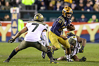 Philadelphia, PA - December 14, 2019:    Navy Midshipmen quarterback Malcolm Perry (10) avoids a tackle during the 120th game between Army vs Navy at Lincoln Financial Field in Philadelphia, PA. (Photo by Elliott Brown/Media Images International)