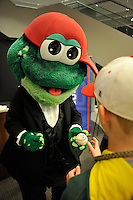 Mascot Reedy Rip'It of the Greenville Drive signs an autograph at the annual Hot Stove Event on Tuesday, January 26, 2016, in the ONE Building in Downtown Greenville, South Carolina. Boston Red Sox General Manager Mike Hazen and Greenville Drive Manager Darren Fenster attended. (Tom Priddy/Four Seam Images)