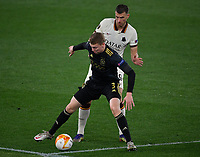 Football: Europa League - quarter final 2nd leg AS Roma vs Ajax, Olympic Stadium. Rome, Italy, March 15, 2021.<br /> Ajax's Perr Schuurs (in front of ) in action with Roma's Edin Dzeko (behind) during the Europa League football match between Roma at Rome's Olympic stadium, Rome, on April 15, 2021.  <br /> UPDATE IMAGES PRESS/Isabella Bonotto