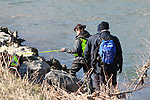BOLZANO - ADIGE - ETSCH -Peter Neumair's Murder Investigation. Salorno, Salurn, Italy on February 13, 2021. In action rescue squad and Police Investigators using a boat with a dog to search for the body of the father of Benno Neumair in the Adige River.  Police with sniffer dog