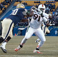 Miami defensive lineman Olsen Pierre (91). The Miami Hurricanes defeated the Pitt Panthers 41-31 at Heinz Field, Pittsburgh, Pennsylvania on November 29, 2013.