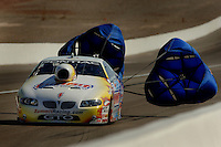 Apr 8, 2006; Las Vegas, NV, USA; NHRA Pro Stock champion Greg Anderson, driver of the Summit Racing Pontiac GTO slows to a stop after qualifying for the Summitracing.com Nationals at Las Vegas Motor Speedway in Las Vegas, NV. Mandatory Credit: Mark J. Rebilas