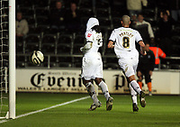 Pictured: Jason Scotland of Swansea (L) celebrating his opening goal with team mate Darren Pratley (R).<br /> Picture by D Legakis / Athena Picture Agency, Swansea, 07815441513