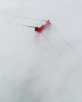 aerial photograph of the Golden Gate Bridge emerging through the fog, San Francisco, California