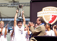 Sky Blue FC's Christie Rampone right holds up the WPS Trophy after winning the WPS Championship match 1-0 over LA Sol at the Home Depot Center, Saturday, August 22, 2009.