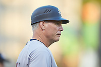 Scranton/Wilkes-Barre RailRiders bullpen coach Doug Davis (15) coaches third base during the game against the Charlotte Knights at BB&T BallPark on August 14, 2019 in Charlotte, North Carolina. The Knights defeated the RailRiders 13-12 in ten innings. (Brian Westerholt/Four Seam Images)