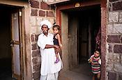 66-year-old Manganiyar artist, Lakha Khan seen spending time with his grandchildren in his house in Raneri village of Jodhpur district in Rajasthan, India. Photo: Sanjit Das/Panos