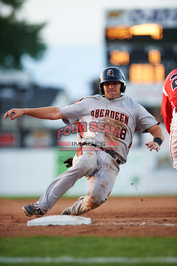 Aberdeen Ironbirds third baseman Collin Woody (48) slides into third base during a game against the Batavia Muckdogs on July 14, 2016 at Dwyer Stadium in Batavia, New York.  Aberdeen defeated Batavia 8-2. (Mike Janes/Four Seam Images)