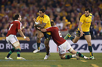 MELBOURNE, 29 JUNE 2013 - Joe TOMANE of the Wallabies of the Wallabies is tackled by Dan LYDIATE of the Lions during the Second Test match between the Australian Wallabies and the British & Irish Lions at Etihad Stadium on 29 June 2013 in Melbourne, Australia. (Photo Sydney Low / sydlow.com)