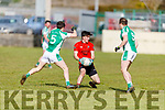 Tommy Quirke of Glenbeigh-Glencar been well marshalled by the Barry brothers Fergal and Andrew of Na Gaeil in the Division 2 game, of the County Football league on Sunday
