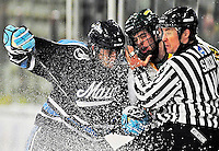 30 October 2010: University of Maine Black Bears' defenseman Mike Banwell, a Senior from Scarborough, Ontario, collides with University of Vermont Catamounts forward Matt White and Linesman Paul Sacco at Gutterson Fieldhouse in Burlington, Vermont. The Black Bears defeated the Catamounts 3-2 in sudden death overtime. Mandatory Credit: Ed Wolfstein Photo