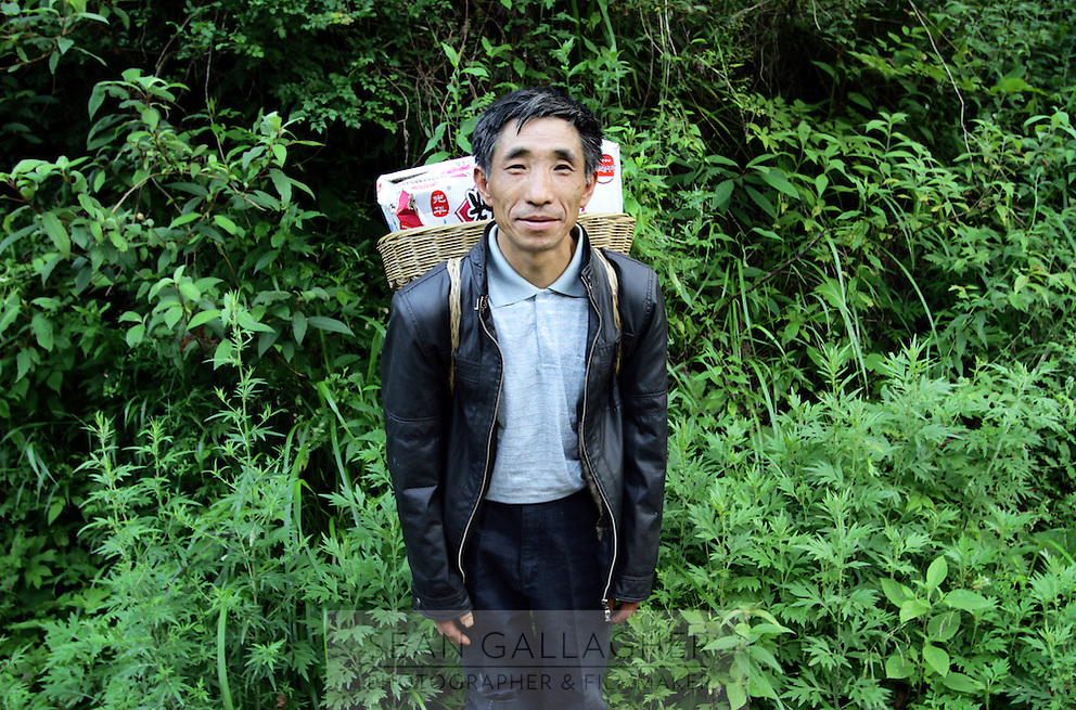 A man in the forests of Pingwu County in northern Sichuan Province, south-west China.