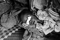 Kalma IDP camp, South Darfur, July 29 2004.Abacar Abdallah, 25 months old, just died from severe malnutrition, weighing at only 5.2kg. He was one of 2000 children in the MSF emergency nutrition program in this camp.