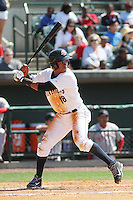 Charleston RiverDogs shortstop Abiatal Avelino #18 at bat during a game against the Greenville Drive at Joseph P. Riley Jr. Ballpark  on April 9, 2014 in Charleston, South Carolina. Greenville defeated Charleston 6-3. (Robert Gurganus/Four Seam Images)