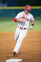 Josh Genthe (8) of the Belmont Abbey Crusaders rounds third base against the Catawba Indians at Abbey Yard on February 7, 2017 in Belmont, North Carolina.  The Crusaders defeated the Indians 12-9.  (Brian Westerholt/Four Seam Images)