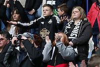 Swansea fans watch on during the Barclays Premier League match between Leicester City and Swansea City played at The King Power Stadium, Leicester on April 24th 2016