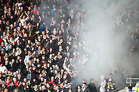Swansea fans set off a smoke bomb   during the Emirates FA Cup 3rd Round between Oxford United v Swansea     played at Kassam Stadium  on 10th January 2016 in Oxford