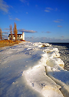 Winter ice and snow at Point Betsie Lighthouse near Frankfort. Frankfort Michigan USA Lake Michigan.