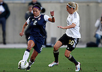 USA's Sydney Leroux fights for the ball with Germany's Lena Goebling during their Algarve Women's Cup soccer match at Algarve stadium in Faro, March 13, 2013.  .