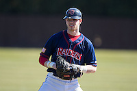 Jake Kennedy (30) of the Shippensburg Raiders warms up in the outfield prior to the game against the Belmont Abbey Crusaders at Abbey Yard on February 8, 2015 in Belmont, North Carolina.  The Raiders defeated the Crusaders 14-0.  (Brian Westerholt/Four Seam Images)