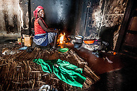A woman cooks food on an open fire inside the former Grand Hotel building. Once a luxury destination for the wealthy and the continent's biggest hotel, the building is now a concrete shell and home to about 6,000 squatters. Those unable to occupy one of the rooms sleep in the corridors, basements and even on the roof of the building.