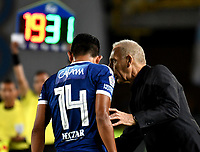 BOGOTA - COLOMBIA - 18 – 02 - 2018: Miguel Angel Russo (Der.), técnico, de Millonarios, da instrucciones a David Silva (Izq.) jugador de Millonarios, durante partido de la fecha 4 entre Millonarios y Atletico Nacional, por la Liga Aguila I 2018, jugado en el estadio Nemesio Camacho El Campin de la ciudad de Bogota. / Miguel Angel Russo (R), coach of Millonarios, gives instructions to David Silva (L) player of Millonarios, during a match of the 4th date between Millonarios and Atletico Nacional, for the Liga Aguila I 2018 played at the Nemesio Camacho El Campin Stadium in Bogota city, Photo: VizzorImage / Luis Ramirez / Staff.
