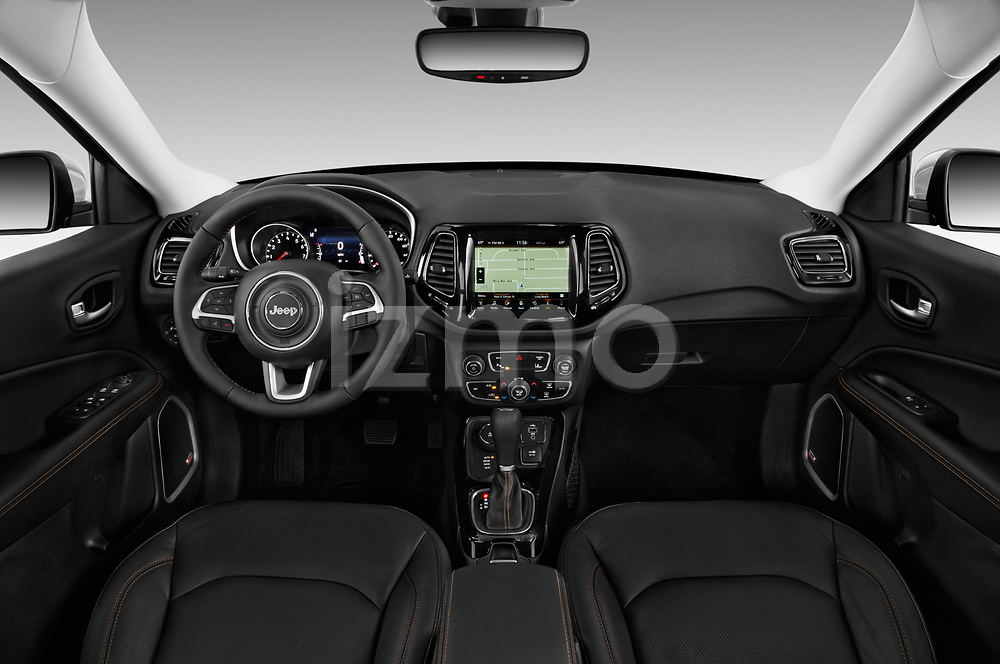Stock photo of straight dashboard view of a 2018 Jeep Compass Limited 4WD 5 Door SUV