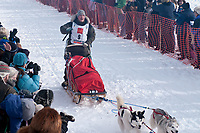Blake Matray team leaves the start line during the restart day of Iditarod 2009 in Willow, Alaska
