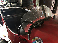 BNPS.co.uk (01202 558833)<br /> Pic: CharterhouseAuctioneers/BNPS<br /> <br /> Pictured: The sports car.<br /> <br /> A 1933 three-wheel sports car has been discovered hidden away in an old barn where it languished for decades.<br /> <br /> The cherry red Morgan Super Sports belonged to its owner for 30 years and was used to tour across Europe with his wife.<br /> <br /> In his later years, he struggled to fit inside his 'beloved car' so his family cut part of the steering wheel, allowing him to sit in it and reminisce on his driving days.