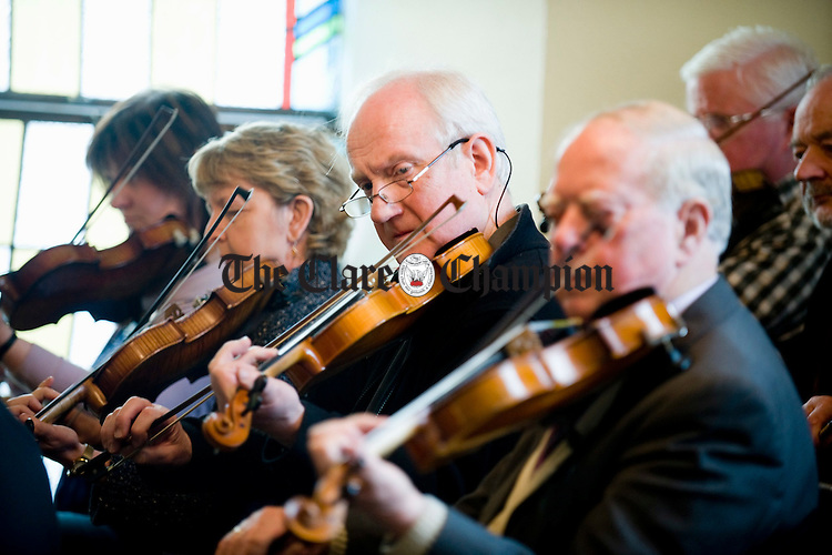 Fiddler John Kelly, centre, was amongst those who played at the funeral of Joe Ryan in Inagh.