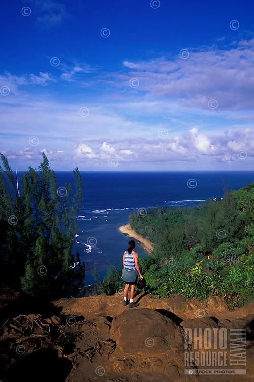 Hiker on the Kalalau Trail looks down at Kee Beach