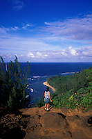 Hiker on the Kalalau Trail looks down at Kee Beach