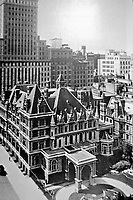 The Cornelius Vanderbilt II House was a mansion built in 1883 at 1 West 57th Street in New York City. this image is from a poster of an aerial view of the Crown Building and Vanderbilt Mansion, New York. George B. Post and Richard Morris Hunt, architects.