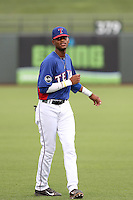 Ti'Quan Forbes #19 of the AZL Rangers warms up before a game against the AZL Cubs at Surprise Stadium on July 6, 2014 in Surprise, Arizona. (Larry Goren/Four Seam Images)