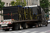 A truck loaded with fencing drives away from Lafayette Square near the White House in Washington D.C., U.S., on Thursday, June 11, 2020.  Additional fencing that had been added around the White House due to protests over the death of George Floyd is slowly being removed.  Credit: Stefani Reynolds / CNP/AdMedia