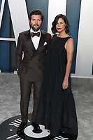BEVERLY HILLS, LOS ANGELES, CALIFORNIA, USA - FEBRUARY 09: Adam Scott and Naomi Scott arrive at the 2020 Vanity Fair Oscar Party held at the Wallis Annenberg Center for the Performing Arts on February 9, 2020 in Beverly Hills, Los Angeles, California, United States. (Photo by Xavier Collin/PictureGroup)