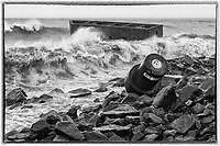 """Buoy's Refuge in a Storm<br /> Despite being pounded by relentless waves, """"Uncle Harvey's Mausoleum"""" held its ground. A buoy broke free and washed up on shore."""