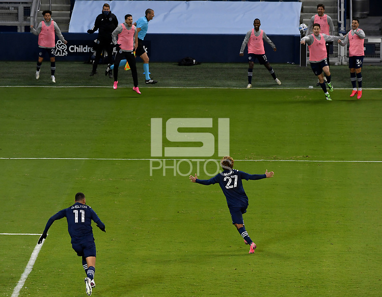 KANSAS CITY, KS - NOVEMBER 22: Khiry Shelton #11 and Gianluca Busio #26 of Sporting KC celebrate Busio's goal in the final minutes of the game before a game between San Jose Earthquakes and Sporting Kansas City at Children's Mercy Park on November 22, 2020 in Kansas City, Kansas.